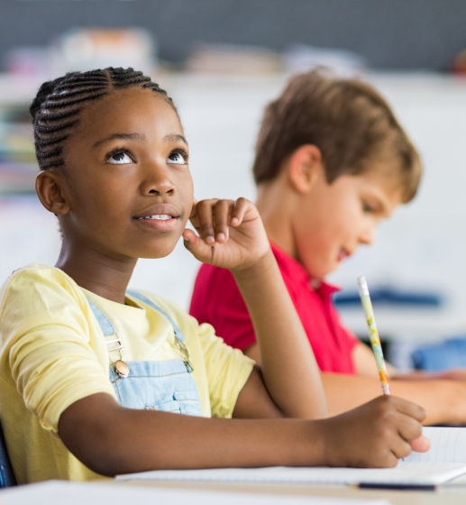 African girl thinking in classroom