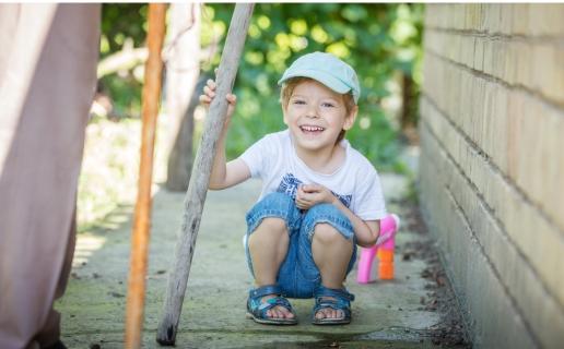 Cute little boy playing outside