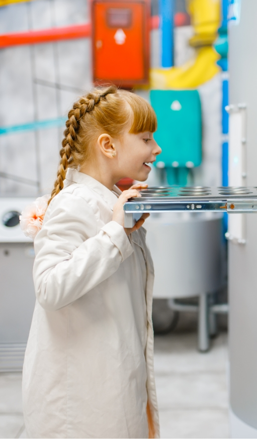 Little girl playing doctor analysis laboratory